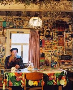 """""""Stepas House"""" where all of the walls are collaged with memories i want the tablecloth!"""