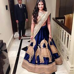 """Director of Aza, Devangi Nishar looked absolutely breathtaking in a Sabyasachi lehenga at her grand reception in Mumbai. Indian Attire, Indian Wear, Indian Dresses, Indian Outfits, Manish Malhotra Bridal Lehenga, Royal Blue Lehenga, Indische Sarees, Party Kleidung, Bastilla"