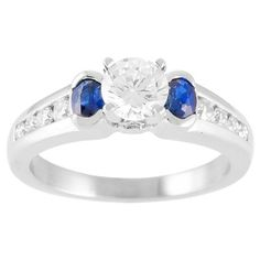 Classic 3 stone diamond and sapphire engagament ring. 4 prong center, half bezel sapphires and tappered out round channel set shank.  0.68ct (not incl. center stone)  Style #5548SAP    Head Shape:Any Shape  Center Size:Any Size  Metal:Any Metal  Wedding band:3.4 x 2.7 mm  Ring Width mm:5.3 x 4.2x2.3  Suggested Center:5.5 mm up  Matching Band: 5548DW