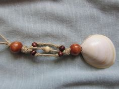 Sea Shell Necklace with Hemp Cord and Wooden Beads by FruFruDesign, $18.00