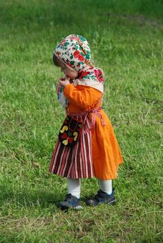 Little girl wearing a traditional Swedish costume (folkdräkt) during Midsommar
