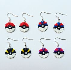 A pair of super-cute Pokeball earrings, perfect for any Pokemon fangirl (or fanboy!) Handmade using mini Hama / Perler beads with silver-plated earrings. Ive used a circular board for a more realistic effect. Available in the following designs: - Poke Ball (red and white) - Great Ball (blue and red) - Ultra Ball (black and yellow) - Master Ball (purple and pink) Love them all? Just select Full Set of Four from the drop-down menu to receive one pair of each. Both sides have been ironed fo...