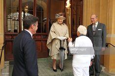 Lord Sebastian Coe (L), Queen Elizabeth II and Prince Philip, Duke of Edinburgh…