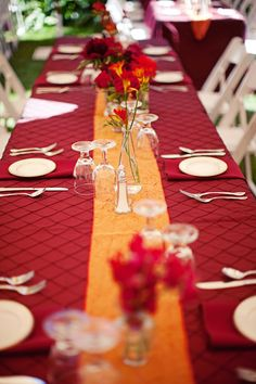reception tabletop details - dark red linens with golden yellow accents - photo by Southern California wedding photographer Meg Perotti