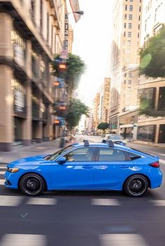 Versatility has never been this fun. *Civic Sport Touring Hatchback shown with accessory roof rack and 18-inch alloy wheels Honda Civic Hatchback, New Honda, Roof Rack, Alloy Wheel, Touring, Sporty, Cabin, Wheels, Fun