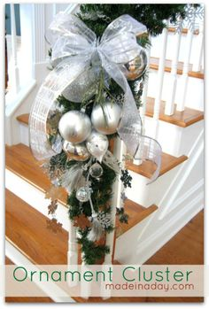 Ornament Cluster Arrangement! For the bottom of stairs, middle, and top. lined with garland. Topped off with a big bow.