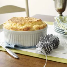 Savory soufflé featuring grits and Cheddar cheese is a perfectly festive brunch dish for special occasions.