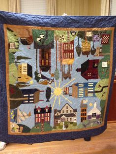 A group of twelve of us made this All Around The Town Quilt for a dear friend this past summer.