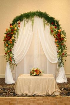 Wedding Arch like the fabric hanging down. not the flowers