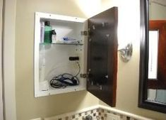 Customized with an electrical outlet to charge that electric toothbrush out of sight!