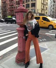 Punk-inspired street style Band t-shirt, black faux fur jacket, and rust high-rise flair pants. -MB - ̗̀ @artsyautumn ̖́-