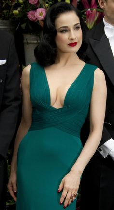 I love the way this highlights the waist. Dita Von Teese this look could be accomplished just as easy and beautiful with a higher neckline but it is stunning love the dress and color and lighter skin we don't all need to tan to be beautiful