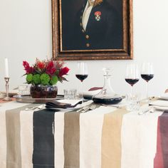 The hand-painted stripe design of the Cinta Tableclothsby Huddleson Linens recalls party ribbons laid across the table and will bring cheer to your next gather