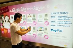 PayPal is running a pilot in Singapore's subway stations to enable Singaporean commuters to shop and pay on-the-go with QR Codes (image and video below). The pilot is now live across 15 subway stations island wide with eight merchants participating by offering Valentine's gifts at special prices including flowers, chocolates, fashion totes, spa massages, iPhone controlled RC cars, entertainment shows and city tours for couples.