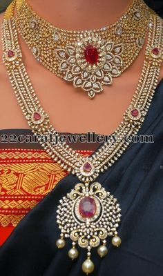 22 carat gold huge diamond necklace with floral designer motif embellished in the center with rubies. Paired with same patterned diamond ...