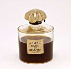 1940 Chanel Le 1940 Bleu de Chanel perfume bottle, glass, frost stopper, label. Chanel-France molded on base. 2 3/4 in.
