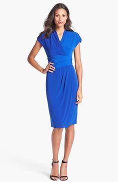 Love the color and style. Versatile dress...wearable day and/or night!