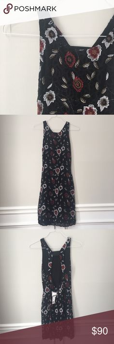 Willow and Clay beaded embroidered Dress NWT Black last dress with delicate flower beading over top. Open back is perfect for a date night out or a party. Guaranteed to get you tons of complements! Fits medium or small Willow & Clay Dresses Midi