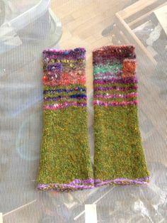 Cute green and flowery-colored spring fingerless gloves.