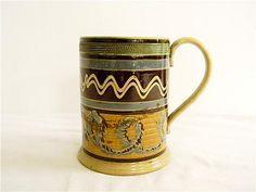 "19th century mochaware mug, 6 1/2"" high with polychrome decoration."