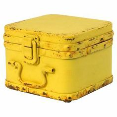 "Bring a touch of industrial-chic charm to your living room or den with this eye-catching storage box, crafted from metal and showcasing a yellow finish.  Product: Storage boxConstruction Material: MetalColor: YellowFeatures:  Lock lidOne handleDimensions: 4.5"" H x 3.5"" W x 4.5"" DCleaning and Care: Lightly dust"