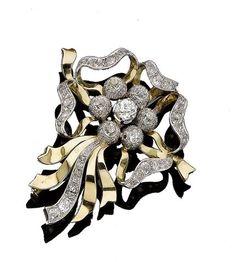 A diamond bow brooch/pendant