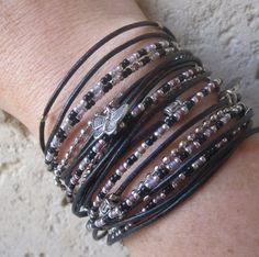 Boho Chic Black Leather Triple Wrap Bracelet with Silver, black and purple Miyuki beads. $38.00, via Etsy.