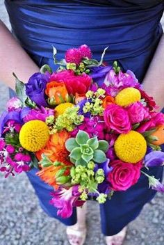 colorful bridal bouquet. see how to choose the right bouquet for your wedding theme here: http://www.mywedding.com/articles/wedding-bouquets-by-theme/