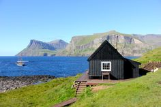 I love black cottages (or houses) with white trim.  Love how this cabin is precariously placed so close to the water.  (Cabin near Tintholmen, Faroe Islands.  From Free Cabin Porn.)