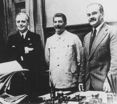 Nazi foreign minister Joachim von Ribbentrop (left), Soviet leader Joseph Stalin (center), and Soviet foreign minister Viacheslav Molotov (right) at the signing of the nonaggression pact between Germany and the Soviet Union. Moscow, Soviet Union, August 1939.