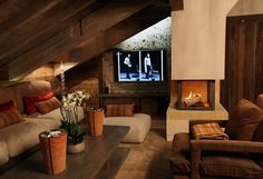 Minimalist ski-lodge fireplace by Halo Design Interiors in the exclusive Courchevel 1850 resort