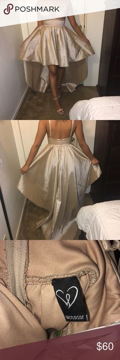 New prom dress for sale !! Never worn Beige / gold new prom dress. It's a high low. Asking price is $60 or better offer! WINDSOR Dresses Prom