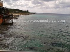 In the early morning cruise ships dock as charter sailing tours, deep sea fishing, dive & snorkel adventures near the reef or deep blue sea. Dock view at Dos Amigos is first stop on land for some cruise ship vacationers on Cozumel Island
