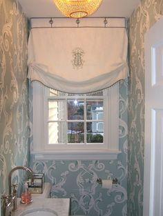 Love this Roman shade .. looks like white linen, lined and interlined.  Fabulous monogram with button detail and glass beads.  NICE - Kevin Malone