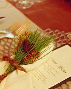 Napkins tied with a bundle of local greenery add a seasonal touch to the table