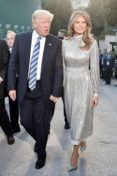 Melania and Donald Trump held hands as they arrived at the Ancient Theatre of Taormina for...