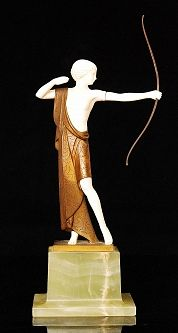 In the manner of Josef Lorenzl - A 1920's French Art Deco bronze and ivory figure of a classically dressed female archer in standing pose, the ivory figure semi clad with bronze draped robes, raised to an integral bronze base above swept alabaster base, unsigned, height 35cm,