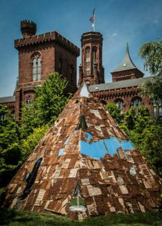 "As part of its exhibition Earth Matters: Land as Material and Metaphor in the Arts of Africa, the National Museum of African Art invited several African artists to do earthworks in the Smithsonian's gardens. These are large sculpture works which use earth as material, motif, and/or message. One of these is ""Ala"" by Ghanaian artist El Anatsui. Read more about the pyramid in the garden on our blog!"