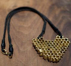 18k gold honeycomb cast from the wax comb of Brooklyn honeybees
