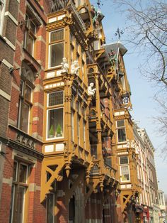 "old balcony of the ""Huis met de kabouters"" (""House with the gnomes"") - built in 1884, Ceintuurbaan (close to the river the Amstel), Amsterdam"