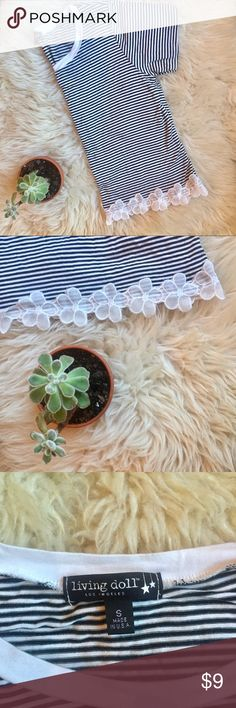 Striped Crop Top Black and white striped crop top trimmed with floral lace. Relaxed fit that doesn't cling to your body. Very cute with denim or colored skinnies! Only worn once, like new condition. Living Doll Tops Crop Tops