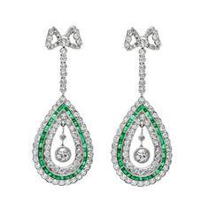 Belle Époque Bow Knot Diamond & Emerald Drop Earrings 1915. Sold for $23,000