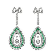 Belle Époque Bow Knot Diamond & Emerald Drop Earrings 1915. Sold for $23,000