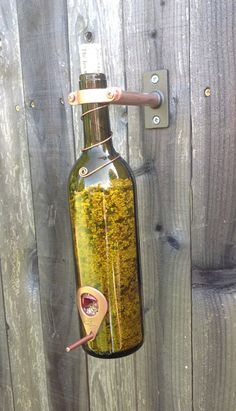 Wine Bottle turned Bird Feeder! Hey, I found this really awesome Etsy listing at https://www.etsy.com/listing/127285973/brown-2-in-1-wine-bottle-bird-feeder-not