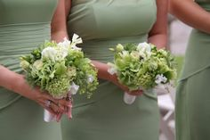 Bridesmaids Posies designed as smaller versions of the bridal bouquet in green shades