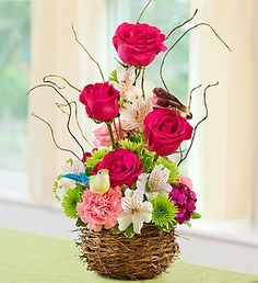 Invite the beauty of spring into your home with our truly original Springtime Bird Nest of Flowers arrangement featuring beautiful bright roses topped with adorable springtime birds!