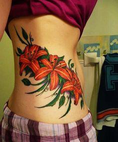 Latest 45 Lily Tattoo Designs for Girls - Beste Tattoo Ideen Hawaiian Flower Tattoos, Flower Wrist Tattoos, Flower Tattoo Back, Hawaiian Flowers, Tattoo Girls, Tattoo Designs For Girls, Delicate Flower Tattoo, Beautiful Flower Tattoos, Lily Tattoo Design