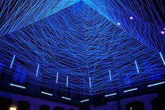 Artist Jeongmoon Choi uses light and thread to create amazing installations that play with aspects of perspective and illusion. Reminiscent of something produced at a laser light show, her fields of three-dimensional lines are installed in place and lit with ultraviolet light to create interactive environments.