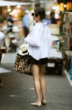 Black skirt and white blouse outfit .. accessorise it with a leopard bag to stand out in the crowd! Be fierce!