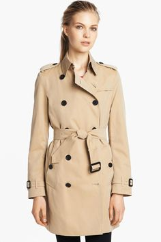 """If you see a Burberry trench for a third off, jump. """"The classic Burberry trench does go on sale, but don't expect to score one for more than 30% off.""""  Burberry London Buckingham Double Breasted Cotton Trench, $1,495, available at Nordstrom."""